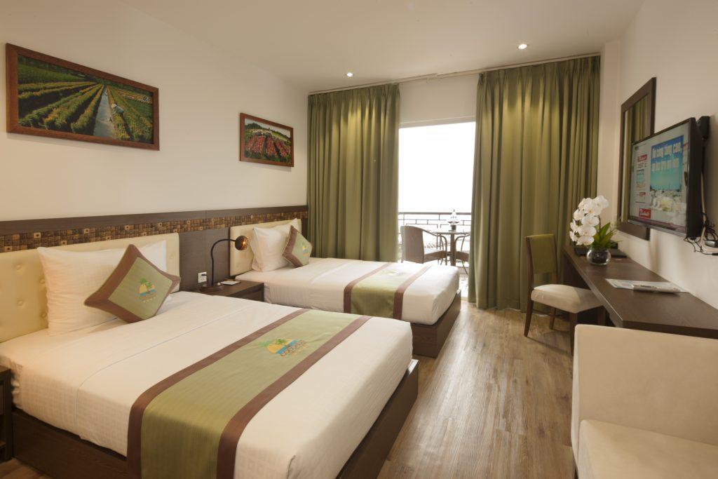Phòng Deluxe Twin River View -Khách Sạn Dừa - Ben Tre Riverside Resort